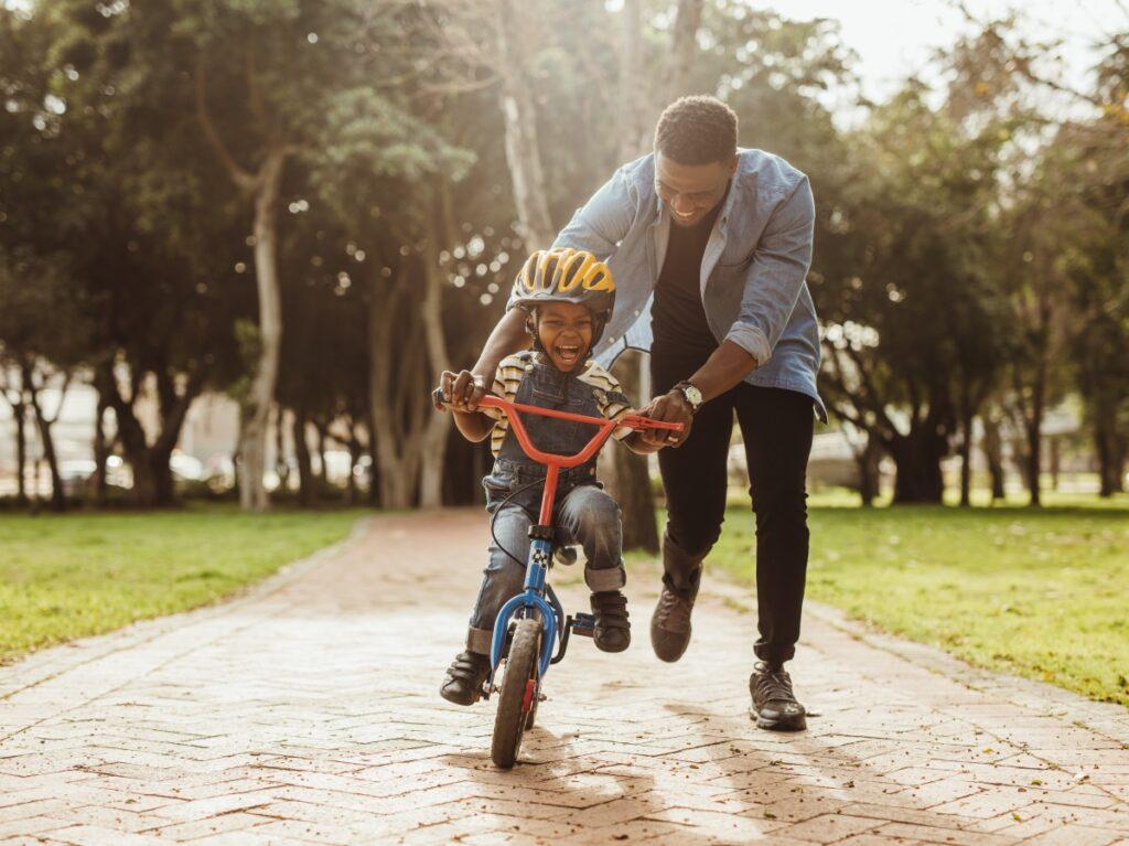 dad and son riding a bike hello joburg