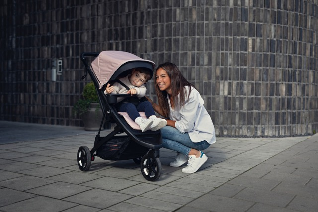 thule stroller with mom and baby
