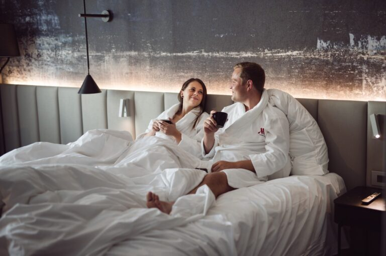 two people lying in bed together