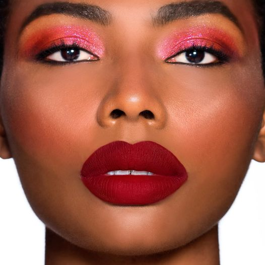 Never underestimate the power of a Powder Kiss red lip