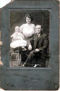 Proud immigrant family has its portrait taken.