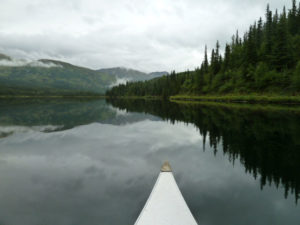 Canoeing in Juneau Lake, Alaska.