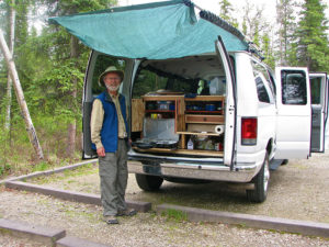 The tarp is up and the kitchen is out in this Alaskan Camper Van