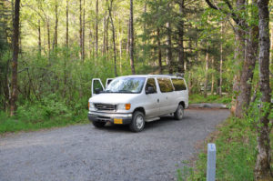A camper van parked at a camp site in Alaska