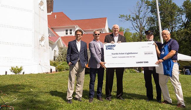Left to Right: Jeff Gales (USLS Executive Director), Jerome Griffith (Lands' End CEO), Tom Barrett (Milwaukee Mayor), Mark Kuehn (North Point Lighthouse Curator), and John Scripp (North Point Lighthouse President)