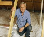Danny Lipford in attic to inspect roof for leaks.
