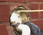 filling crack in brick with insulation