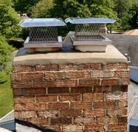 Newly repaired chimney crown and flue cap installation