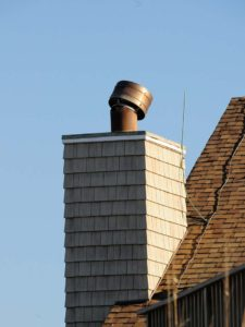 Oceanfront chimney cap damaged