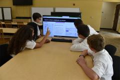 students looking at computer screen