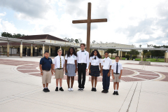 students standing in front of cross
