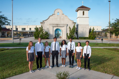 group of students standing in front of chapel