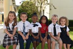 Elementary students smiling at camera