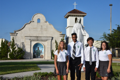 Students standing in front of chapel