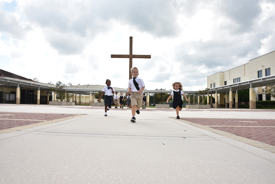 kids running at Catholic school