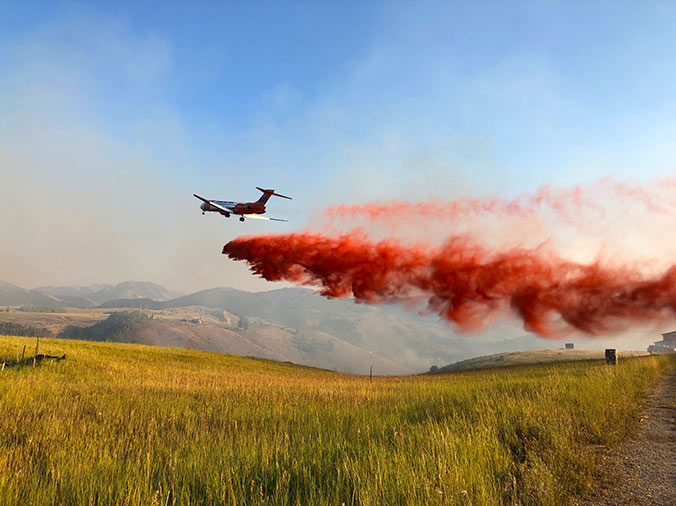 Evacuation Lifted as Crews Work Fire Lines