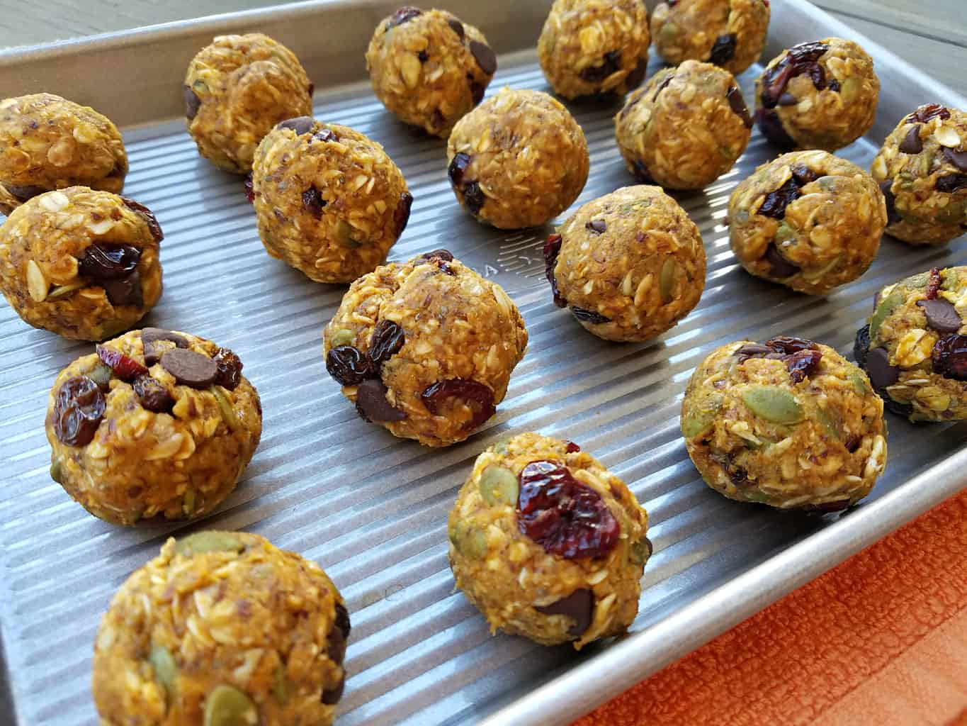 A baking sheet full of No Bake Peanut Butter Pumpkin Balls