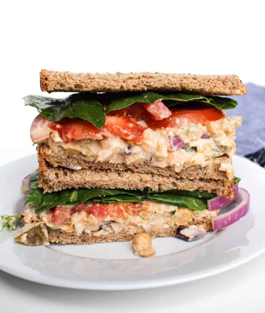 Chickpea tuna salad sandwich served on a white plate