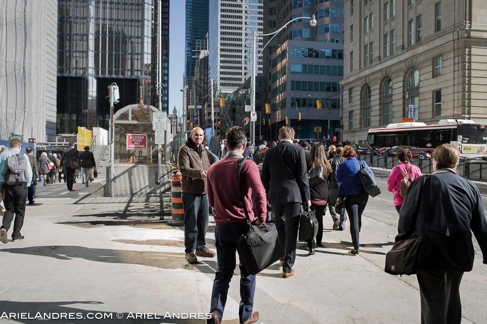 Man handing out the Metro paper to commuters by Union Station, Toronto. Leica M9, 28mm Elmarit