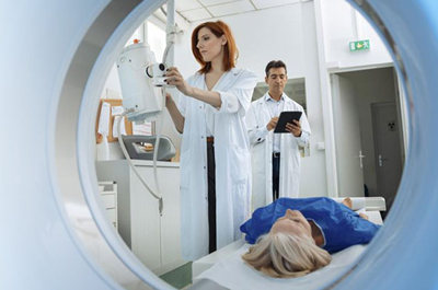 Medical Professional preparing a patient to under go a PET-CT scan.