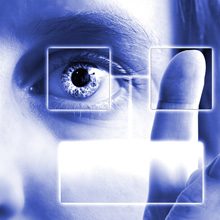 up close image of a researcher using clear screen monitor.