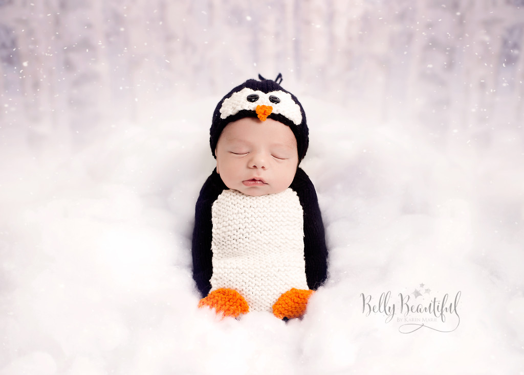 Baby dressed in knit penguin outfit