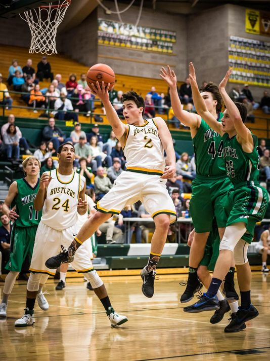 C.M. Russell High's Daniel Silverstein drives to the hoop against Kalispell Glacier on Saturday night.  Photo: Riley Wood