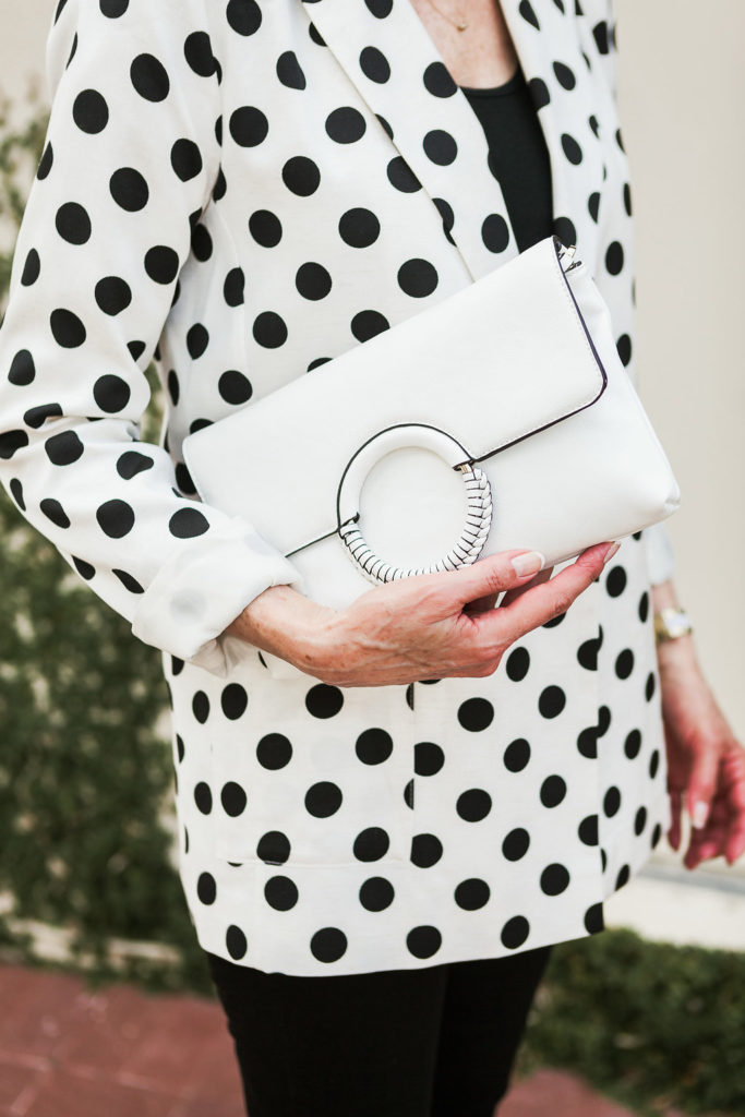 Polka dots on trend and a clutch is always a great accessory for over 50 dressing.