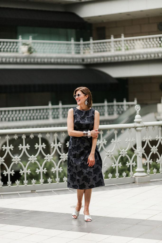 Fashionomics accessorizes Koch navy dress with metallic sandal