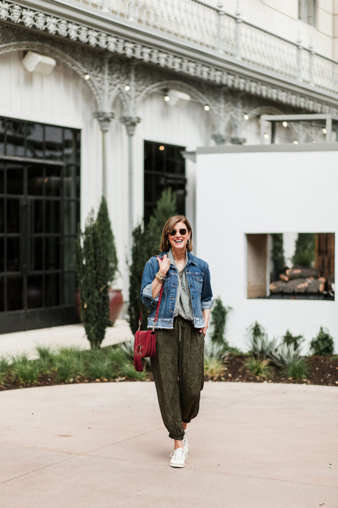 Fashionomics over 50 blogger in joggers and denim jacket