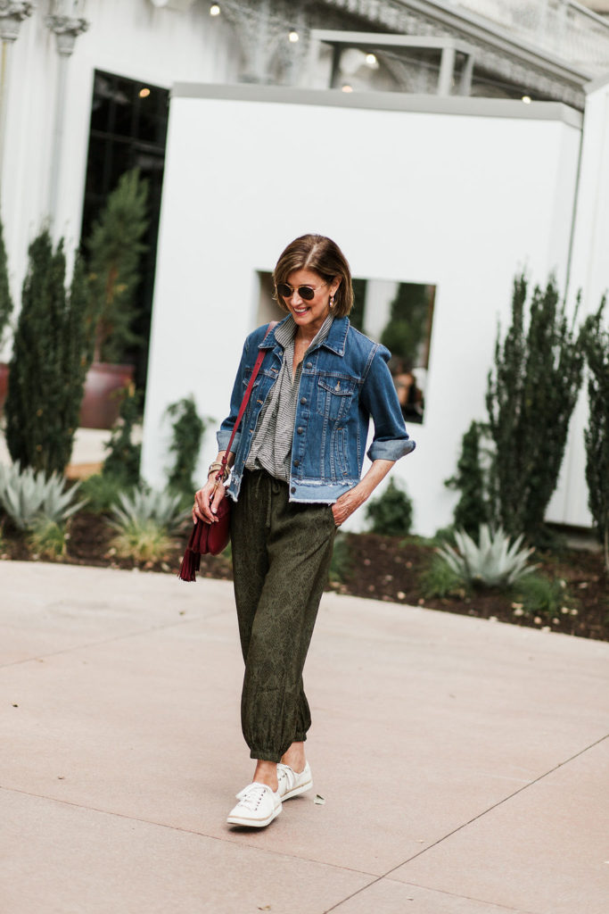 Fashionomics loves cross body bags and sneakers with athleisure looks