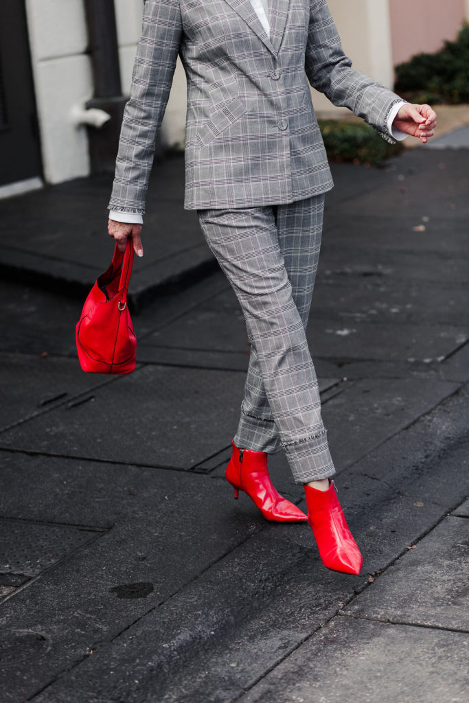red accessories add pop to fall 2018 red booties and rag and bone bag