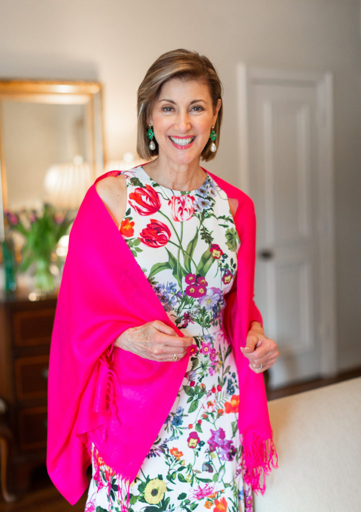 Floral dress and pink pashmina on over 50 blogger