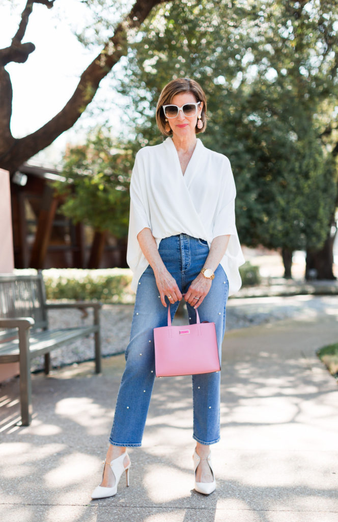 Fashionomics loves a pop of color with a pink top handle bag