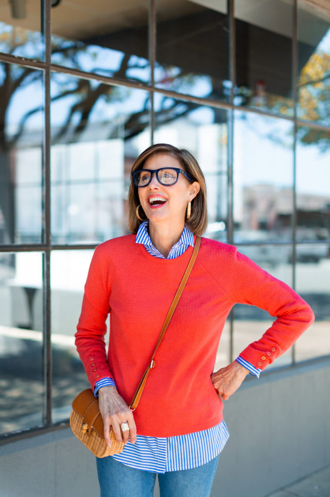 Sightseeing in JMcLaughlin coral sweater and stripe shirt