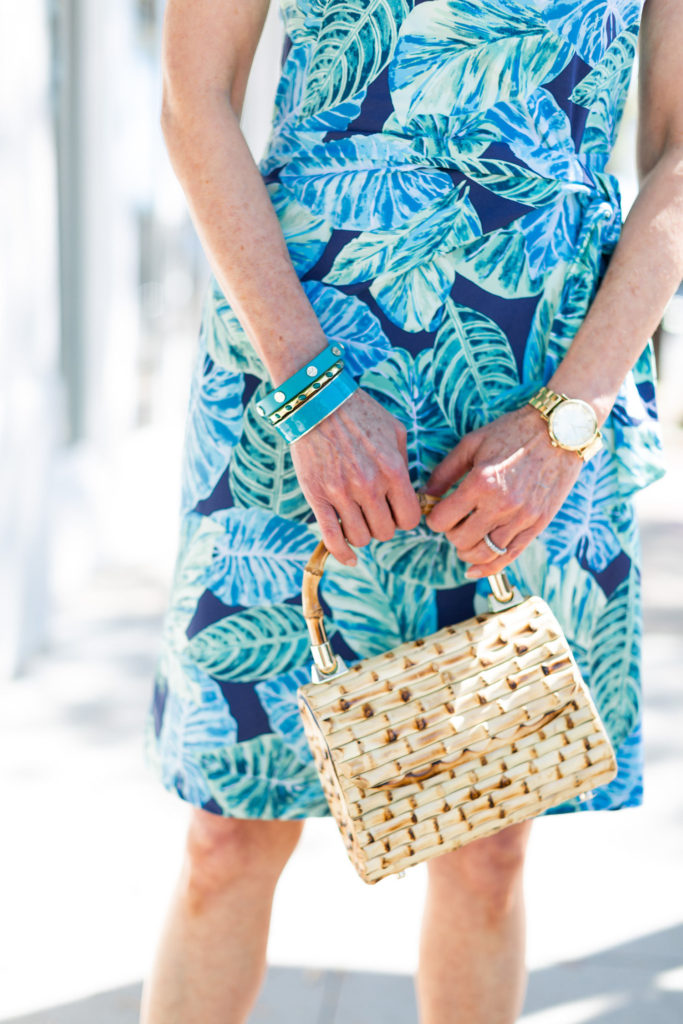 turquoise bracelets and bamboo top handle bag