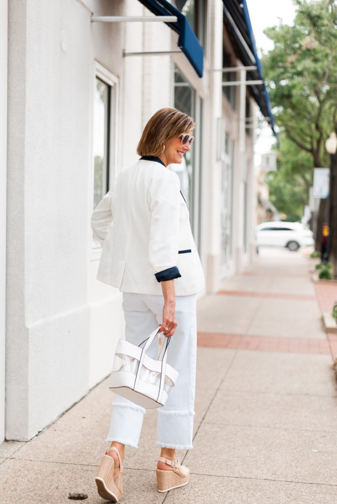 white blazer and jean with neutral wedge
