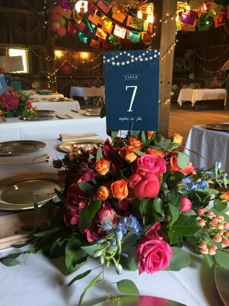 unique pink barn wedding floral centerpieces