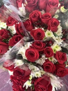 red roses with white filler flower