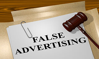 "Court documents with a paper that reads ""FALSE ADVERTISING"""