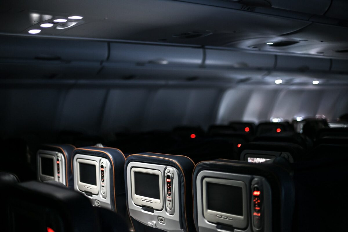 A plane's interior, with empty seats.