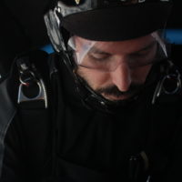 Mike Doke looks down in skydiving plane