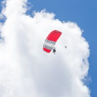 experienced skydivers under canopy against bright blue sky