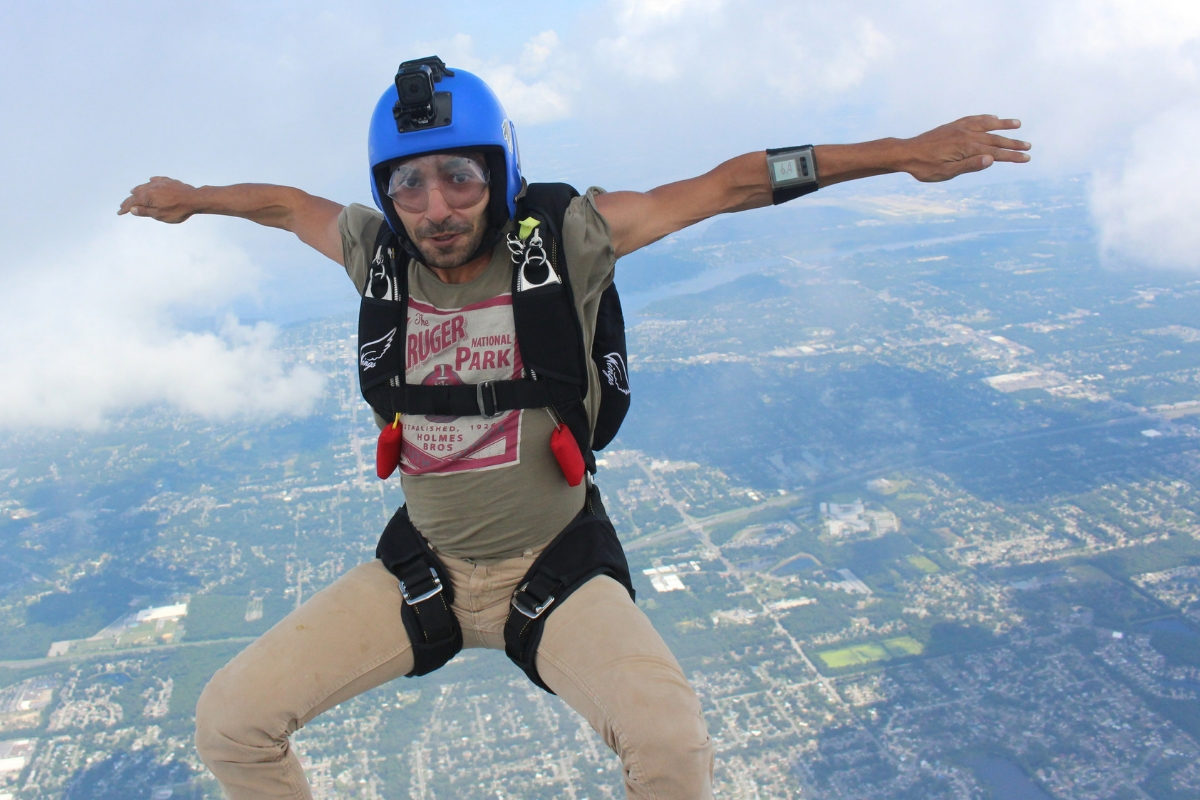 male fun jumper in vertical freefall position