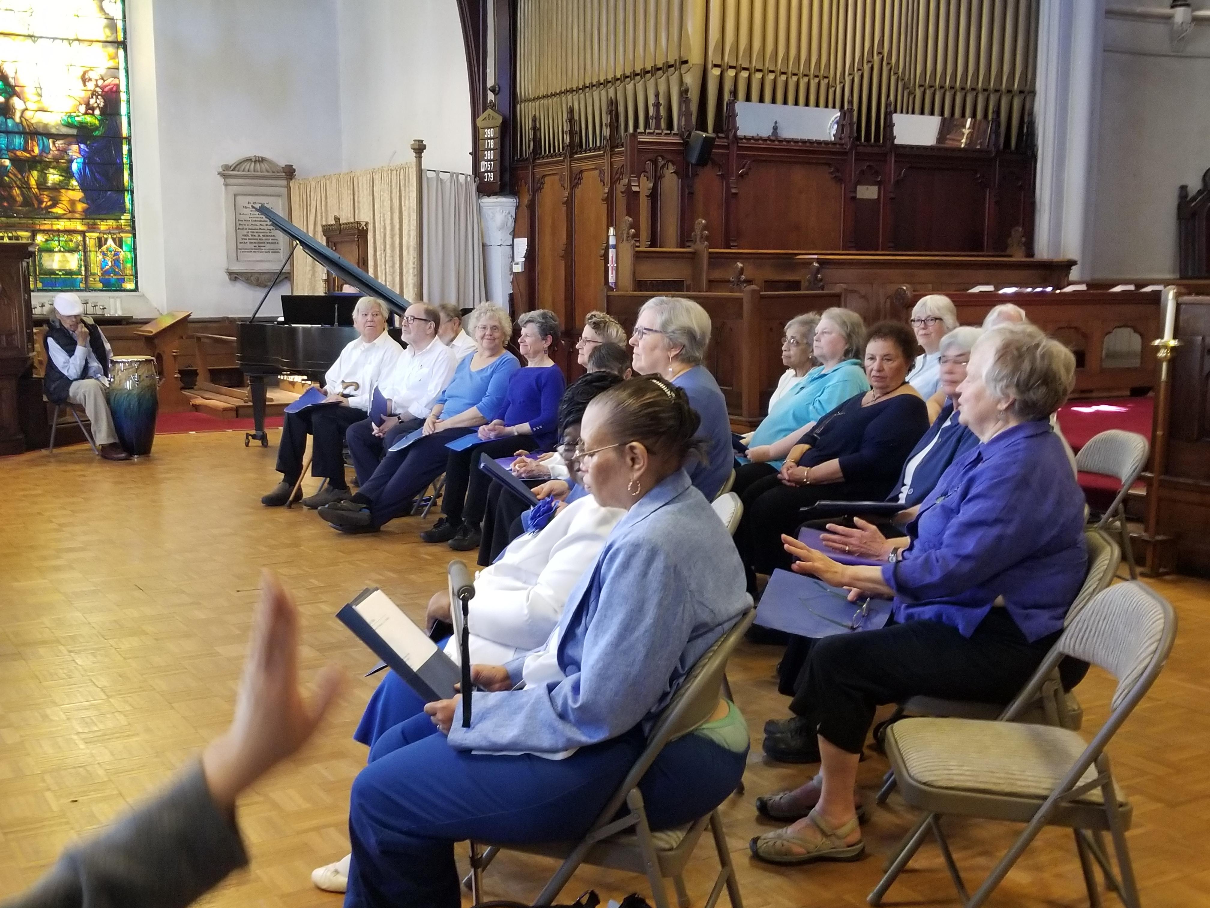 Chorus practice with PACE participants