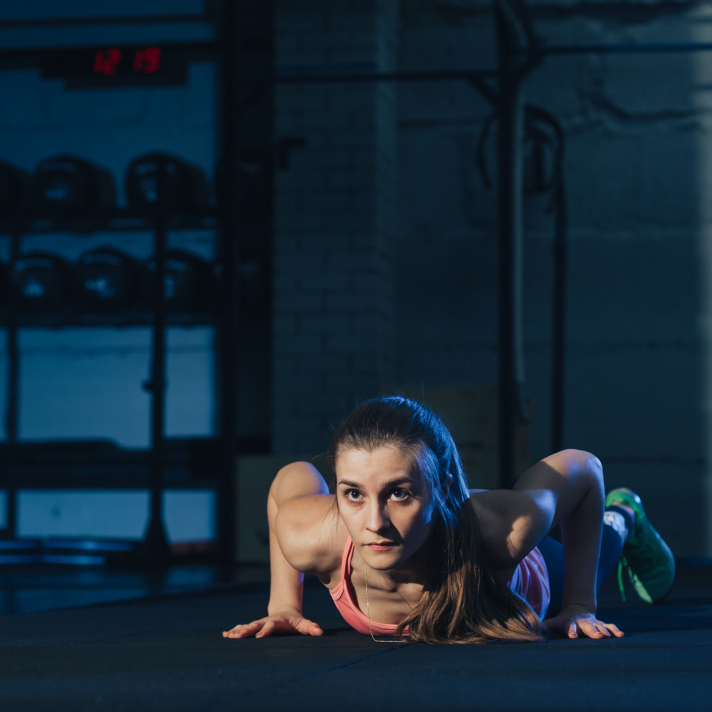 Photo of a women performing a burpee exercise
