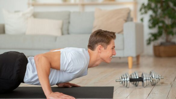 Man perfroming a burpee exercise in his home