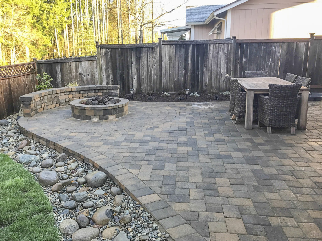 patio with dry river bed and fireplace
