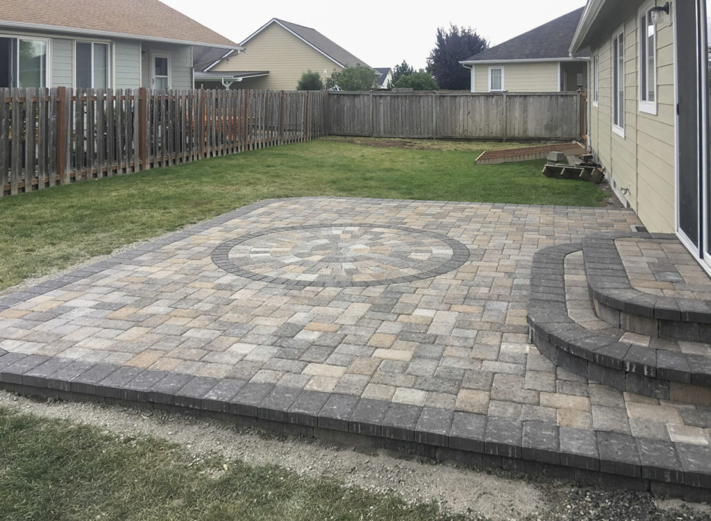 paver patio with circle inset and steps
