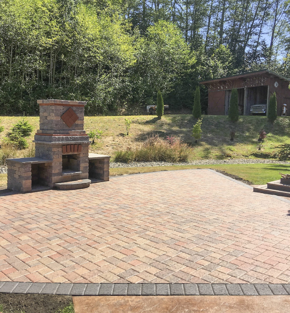 paver patio and outdoor fireplace